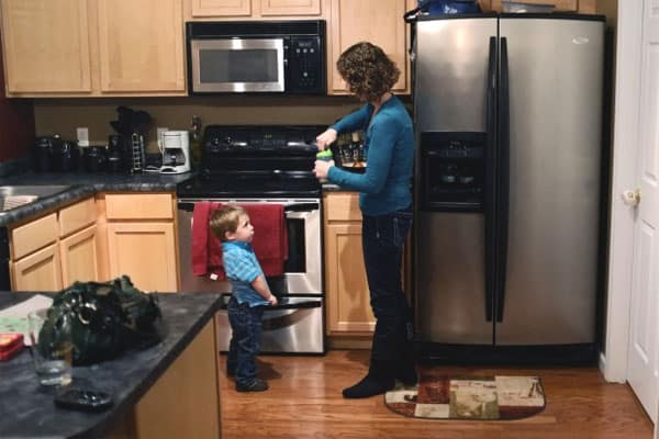 Amy Tucker prepares a bottle of milk for her 2 year-old son, Grant, at their home in Columbia, Ill., on Oct. 17, 2012. Amy had an ovary removed and frozen in 1998 before a cancer treatment. In 2009, the ovarian tissue was returned and she became pregnant with Grant.