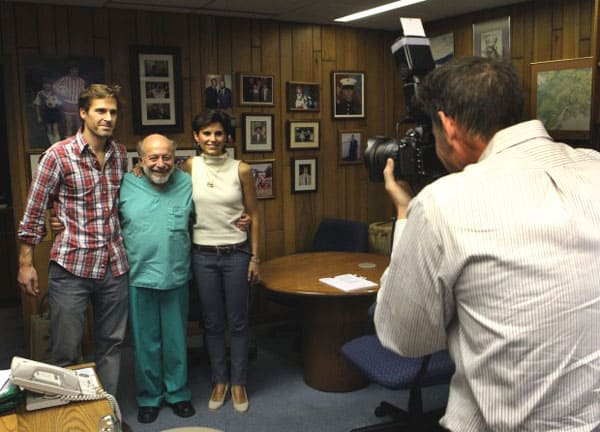 Jenny Remington-Hobbs and her husband pose for a photo with surgeon Dr. Sherman Silber during a pre-op meeting at St. Luke's Hospital in Chesterfield on Oct. 11, 2012. The pre-op visit was being videotaped by the hospital's public relations department.