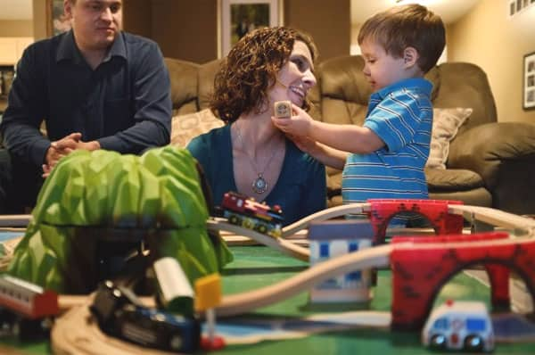 Amy Tucker and her husband, Jason Tucker, play with their 2-year-old son, Grant, at their home in Columbia, Ill., on Oct. 17, 2012. Amy had an ovary removed and frozen in 1998 before a cancer treatment. In 2009, the ovarian tissue was returned and she became pregnant with Grant.