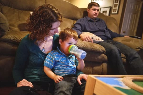 Amy Tucker and her husband, Jason Tucker, relax with their 2 year-old son, Grant, at their home in Columbia, Ill., on Oct. 17, 2012. Amy had an ovary removed and frozen in 1998 before a cancer treatment. In 2009, the ovarian tissue was returned and she became pregnant with Grant.