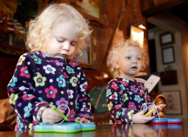 Twins Darby, left, and Reagan Christian play with drawing toys in their Belleville home Monday Dec. 26, 2011. The girls were conceived by parents Fred and Linda Christian through mini in vitro fertilization, a procedure advocated by St. Louis doctor Sherman Silber which, he says, is safer, cheaper and easier on women while maintaining comparable pregnancy rates.
