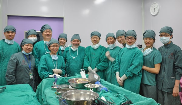 Dr. Silber, center, with Chinese surgical team after successful completion of the operation.