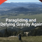 title screen doctor silber in paragliding parachute on a green vista