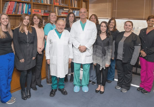 Dr. Silber and Dr. DeRosa with their team of IVF coordinators, nurses, and staff